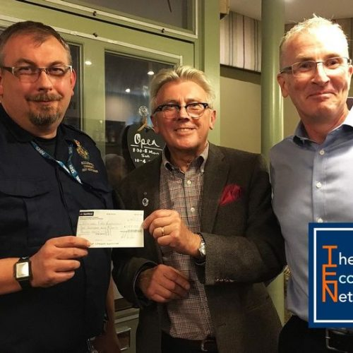 Jay Eames receiving a donation of £180 from The Eccleshall Network